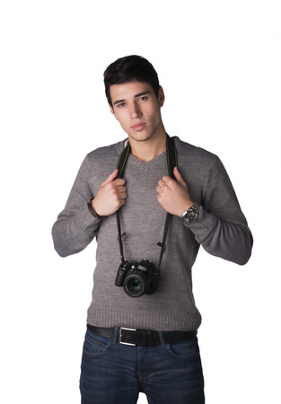 Handsome young man with professional photo camera hanging from his neck, isolated on white photo