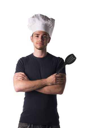 Half Body Portrait of Young Male Chef Wearing Casual Black Shirt and White Hat with Black Ladle on Hand While Looking at the Camera. Isolated on White Background. photo