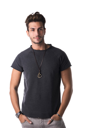 hunk: Fit handsome young man standing confident in casual clothes, looking at camera isolated on white