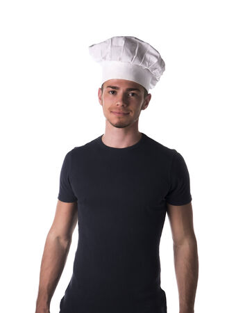 Half Body Portrait of Young Male Chef Wearing Casual Black Shirt and White Hat While Looking at the Camera. Isolated on White Background. photo