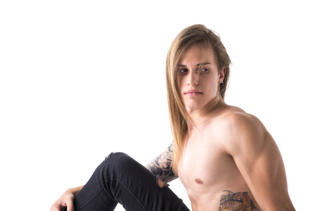 haired: Attractive young man with long hair shirtless, sitting, looking behind, isolated on white