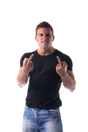 Handsome young man showing middle finger gesturing fuck off photo