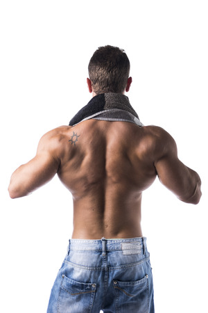 Back of hunky male bodybuilding model drying himself with a grey towel, isolated on white background photo
