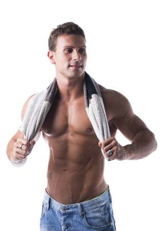 lustful: Hunky male bodybuilding model drying himself with a grey towel, isolated on white background