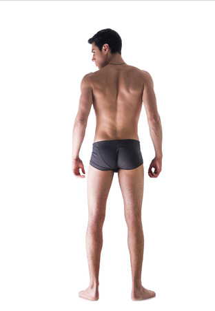 Full back body shot of handsome, fit young man in underwear isolated on white background