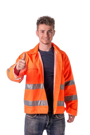 Smiling young construction or road worker doing thumb up sign, isolated on white