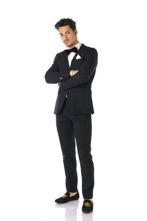 black tie: Handsome elegant young man with suit and bow-tie, full length shot, isolated on white