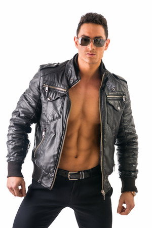 Handsome muscle man wearing leather jacket on naked torso, isolated on white background looking at camera photo