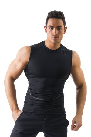 Handsome athletic young man in black t-shirt isolated on white, looking at camera photo
