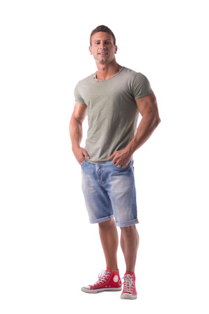full figure: Full figure of handsome young man standing confident in casual clothes, looking at camera isolated on white Stock Photo