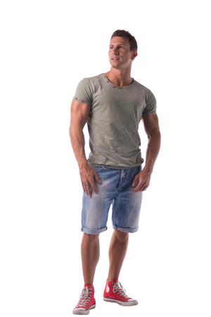 full figure: Full figure of handsome young man standing confident in casual clothes, looking away isolated on white Stock Photo