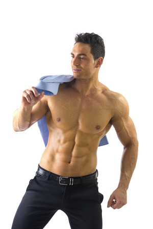 Portrait Of Smiling Handsome Muscular Shirtless Man Holding His Shirt On Shoulder, Isolated on White photo