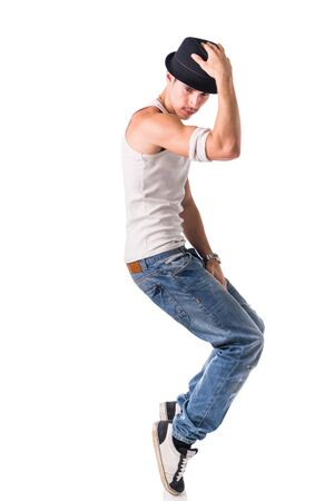 man in jeans: Hip hop dancer showing some movements isolated in white background Stock Photo