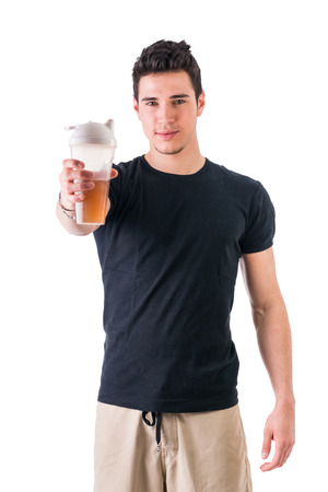 handsome young athletic: Attractive young man holding protein shake bottle. Isolated on white, smiling and looking at camera