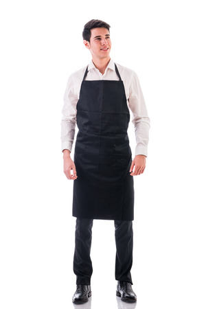 waiter: Full length shot of young chef or waiter posing, wearing black apron and white shirt isolated on white background