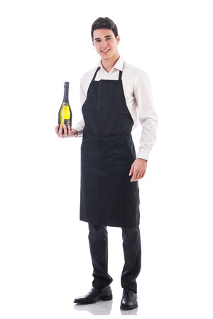 kitchen apron: Attractive young chef or waiter holding green champagne bottle isolated in white Stock Photo