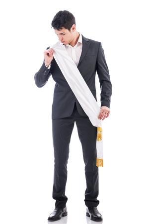 confidently: Young businessman confidently posing wearing winning ribbon or sash, isolated in white background Stock Photo