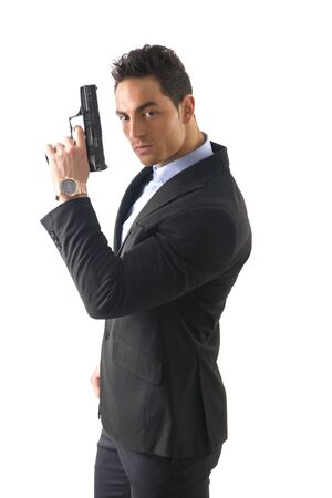 gun man: Elegant man with gun, dressed as a spy or secret agent, with earphones, isolated on white