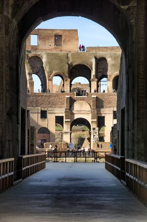 View of Colosseum in Rome, Italy during the day. Detail of the interior architecture photo
