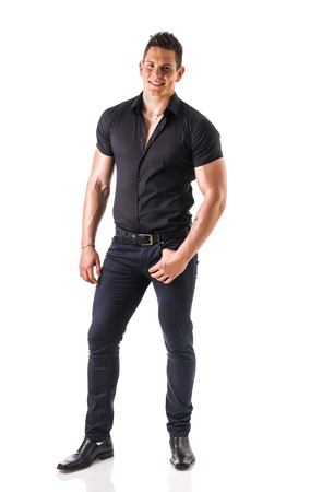 muscular body: Full length shot of young muscular big man wearing stylish black shirt and black jeans looking at camera, isolated on white Stock Photo