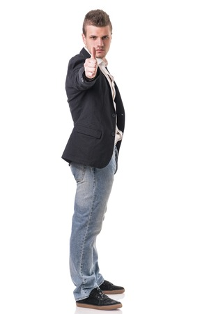 full figure: Elegant man with gun, dressed as a spy or secret agent, with earphones, isolated on white. Full figure shot