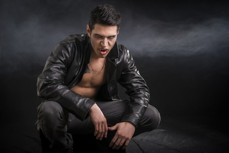Portrait Of An Angry Wounded Young Male Vampire in Black Leather Jacket