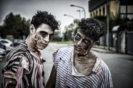 costumes: Two male zombies standing in empty city street looking at camera