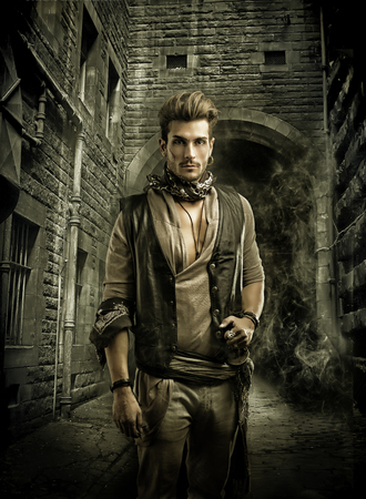 men standing: Good Looking Young Man in Pirate Fashion Outfit in Old Medieval Town Street