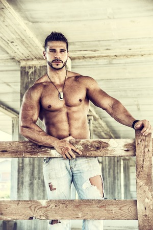 hunk: Muscle man shirtless outdoors in building site. Construction worker Stock Photo
