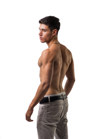 nude back: Handsome shirtless athletic young man in jeans, looking at camera in studio shot, isolated on white background
