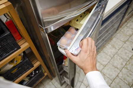 checking ingredients: Hands of young man at home opening fridge for choosing food to eat. Self perspective point of view
