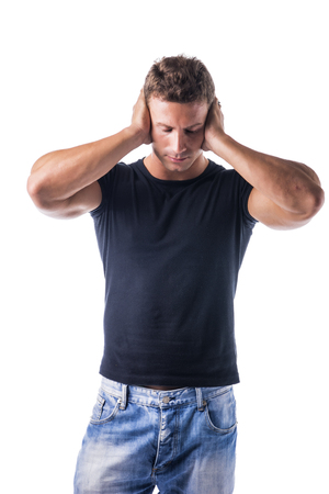 irritated: Irritated, frustrated, stressed guy covering his ears, too much noise