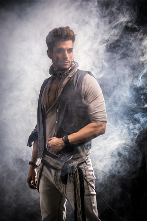 loner: Good Looking Young Man in Pirate Fashion Outfit on Black Background with Smoke. Captured in Studio.