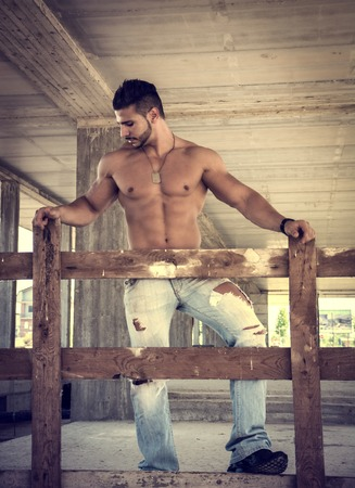 sexy abs: Muscle man shirtless outdoors in building site. Construction worker Stock Photo