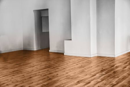unfurnished: View of empty unfurnished room with parquet and white walls Stock Photo