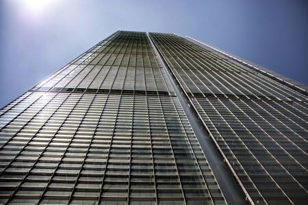 from below: Modern building from below against of blue sky Stock Photo