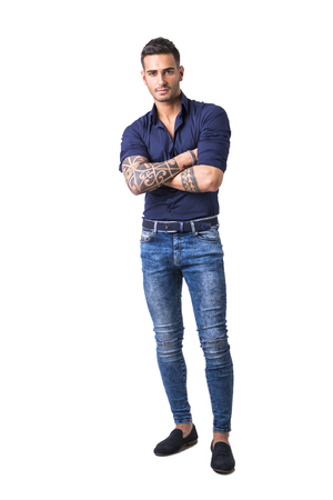 36a04cf86 Handsome young man in blue shirt and jeans posing isolated on white  background in studio,