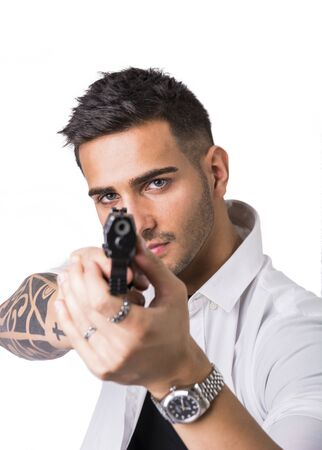 pointing gun: Young handsome man pointing gun, wearing black t-shirt, isolated on white background