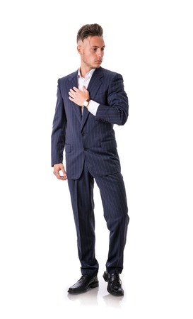 full figure: Full figure shot of handsome elegant young man with suit and neck-tie, isolated on white, looking at camera Stock Photo