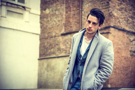 brunets: Elegant attractive young man outdoor wearing wool coat, in European city