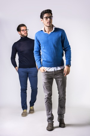 goodlooking: Two good-looking men in stylish clothes.Studio shot.
