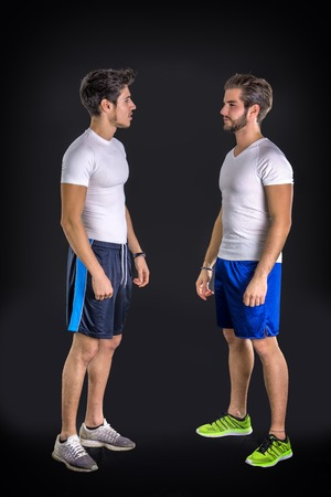 good looking: Two young good looking man wearing sportswear. Studio shot. Stock Photo