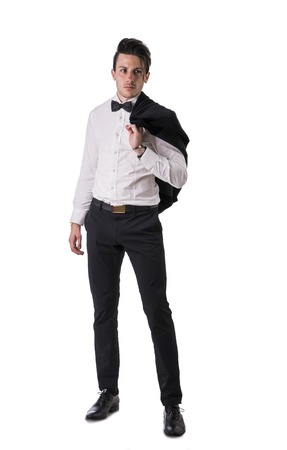 confidently: Young businessman confidently posing and looking at camera, wearing suit isolated on white background Stock Photo