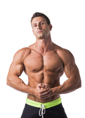Handsome shirtless bodybuilder looking at camera, isolated on white background Stock Photo