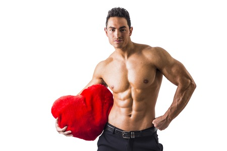 Sexy Shirtless Muscle Man Holding Plush Red Heart Toy, isolated on White Background Stock Photo