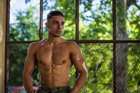 Handsome Muscular Shirtless Hunk Man Outdoor in City Setting. Showing Healthy Body While Looking away