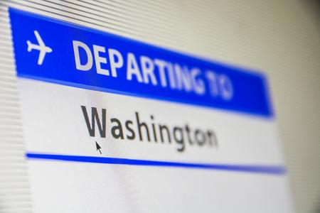 Computer screen close-up of status of flight departing to Washington, DC, USA