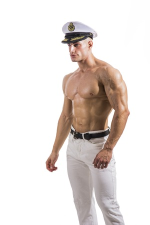 Muscular shirtless male sailor with navy hat, isolated on white Standard-Bild