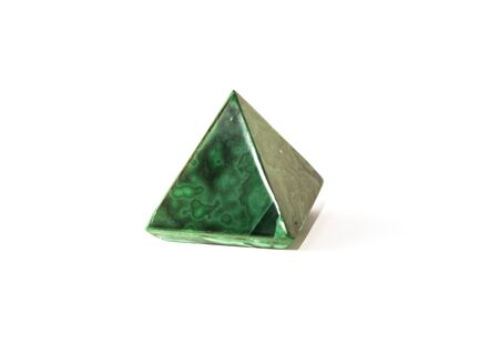 Beautiful malachite pyramid, cut mineral on white background, isolated