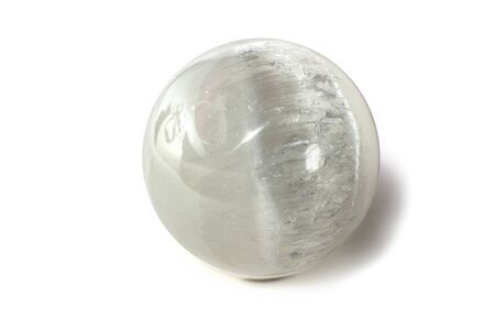 Beautiful white selenite sphere, cut mineral on white background, isolated